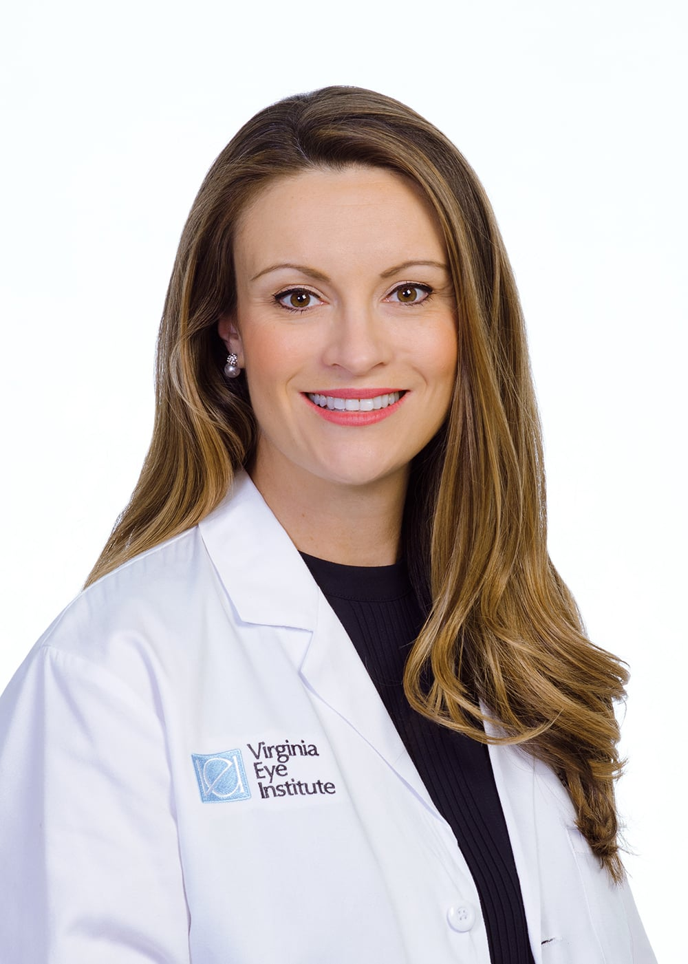 Dr. Nicole Langelier; a caucasian lady in doctors scrubs smiling at the camera in a headshot for virginia eye institute.