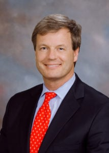 Dr. Will Bearden. A caucasian middle aged male with brown hair and a suit smiling at the camera.
